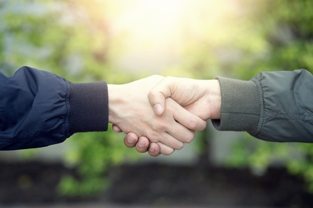 companionship hand clasping success trust, confident concept. or Closeup of a business hand between two colleagues on parks. Stock Photo