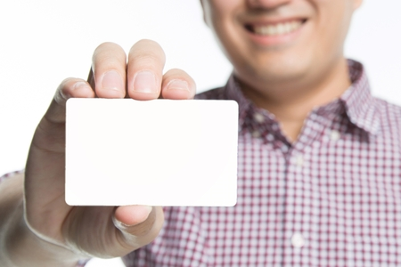 business man in hand hold show blank white card mock up with rounded corners. Plain call-card mock up template holding arm. Plastic credit name card display front. Business branding concept. Imagens
