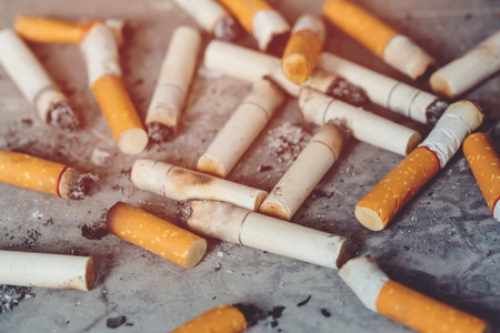 smoking tobacco cigarettes ashtray. Imagens