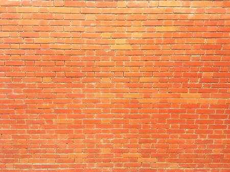 empty brick wall texture painted orange pastel background vintage interior design.