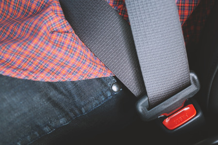 Close Up of people fastening seat safety belt in car for safety before driving on the road. concept transport travel. Imagens