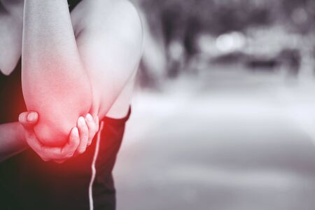 Runner touching painful twisted or broken ankle. Athlete runner training accident. Sport running ankle sprained sprain cause injury knee. and pain with elbow bones. Focus red legs on to show pain.