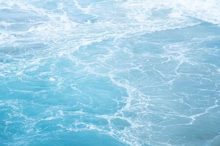 Sea Waves in ocean wave Splashing Ripple Water. Blue water background.