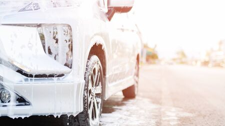 Outdoor car wash with active foam soap outdoor. commercial cleaning washing service concept. Leave space for writing messages. 스톡 콘텐츠