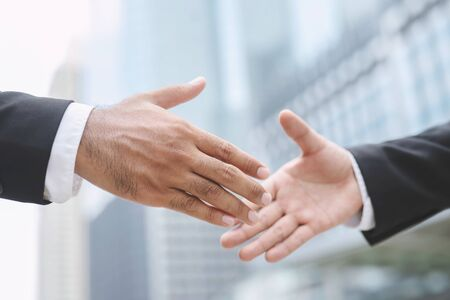 Closeup of a businessman hand shake investor between two colleagues OK, succeed in business Holding hands. 写真素材