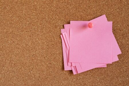 collection of pink pastel color variety post. paper note reminder sticky notes push pin on cork bulletin board. empty space for text.