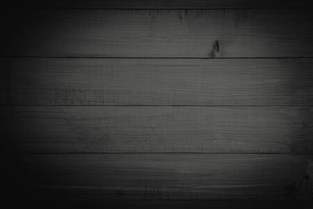 texture wood old grain texture, black dark wall background, top view of wooden table. background in vintage retro color Matte black.