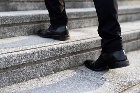 modern businessman working close-up legs walking up the stairs in modern city. in rush hour to work in office a hurry. During the first morning of work. stairway. soft focus. Zdjęcie Seryjne