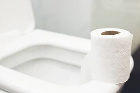 Toilet paper is placed in the bathroom.