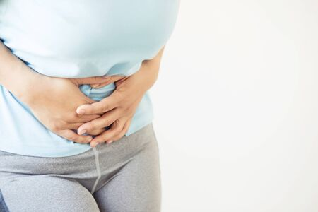 Women have stomach cramps due to abnormal menstruation.