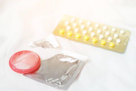 Condoms and birth control pills to control pregnancy