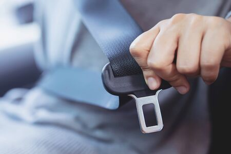 The driver wearing a seat belt for safety