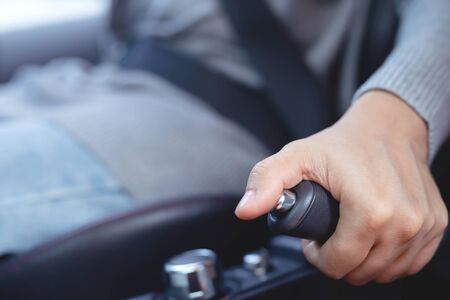 The driver uses a handbrake to stop the car. For safety