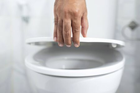 Hand open toilet at home