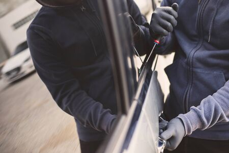 The robber is stealing the car