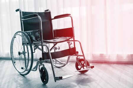 Wheelchair for sick people in the hospital. Фото со стока