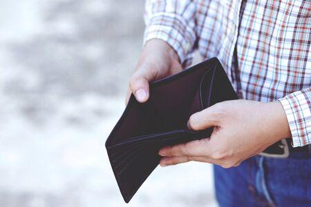 Man hand open an empty wallet isolated Фото со стока