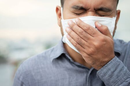 Men wearing masks to protect the corona virus Фото со стока