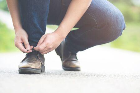 Men tied shoes