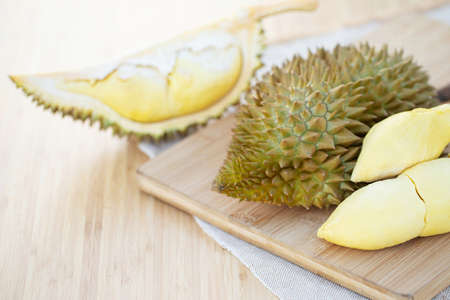 Fresh durian fruit on a wooden plate at the restaurant