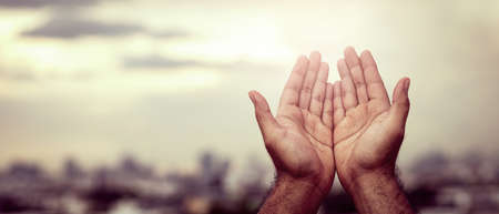 A young man prayed for God's blessings with the power and holiness Stock Photo