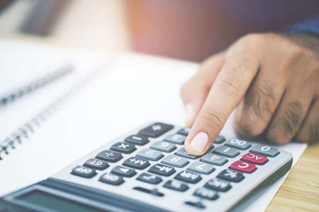 Accountants are calculating financial statements for annual taxes.
