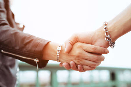 Teenagers shake hands for friendship
