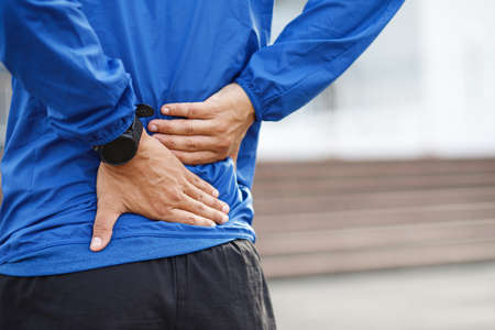 Runners have an inflamed backache at the running track