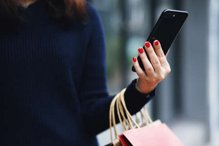 Woman is shopping with mobile phones