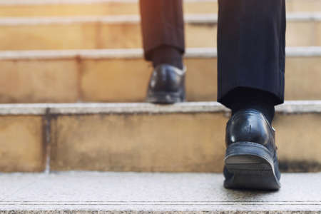 Businessmen are walking up the stairs to work at the office.