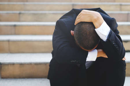 Stressed men get laid off because the economy is depressed.