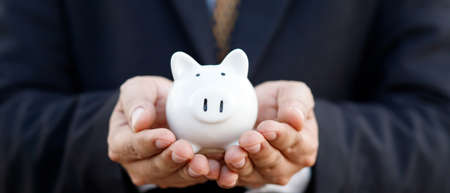 Saving money with pig piggy bank Foto de archivo