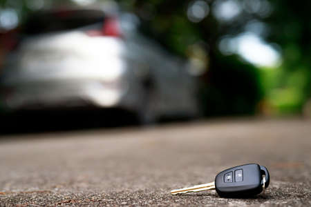 abstract car key fall on the cement ground - can use to display or montage on product 版權商用圖片