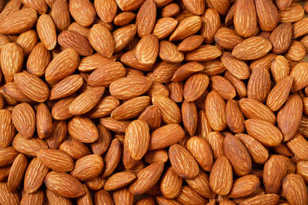 Peeled almonds closeup. For vegetarians.