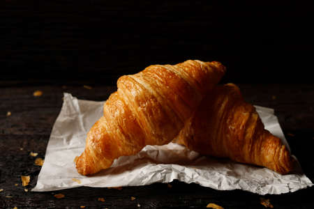 freshly baked croissants on grey wooden table 版權商用圖片
