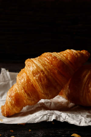 freshly baked croissants on grey wooden table Foto de archivo