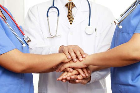 Concept Teamwork doctor and nurses coordinate hands for success work