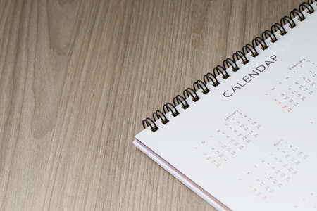 Calendar for annual holidays of office workers on the table Imagens