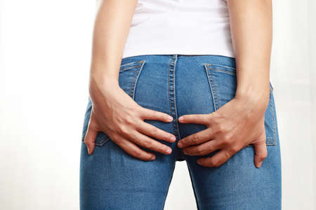 A woman has hemorrhoids, she has a lot of pain in her ass. Imagens