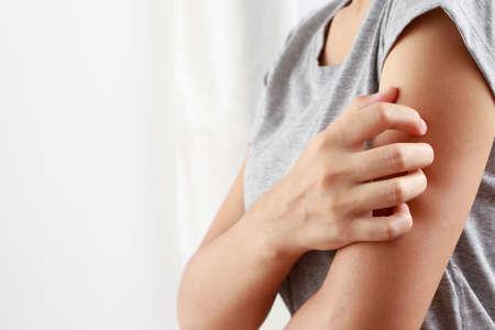 Woman ishaving itchy skin