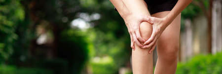 Health problems, women knee pain while exercising in the park
