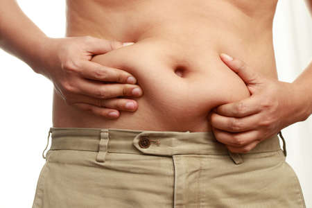 obese men have excess fat ,He is dieting to lose weight. Imagens
