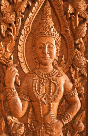 carve on teak at the door of buddisht temple in thailand  photo