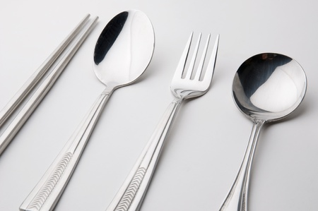stainless steel kitchen: chopsticks spoon and fork stainless steel kitchen utensil isolated