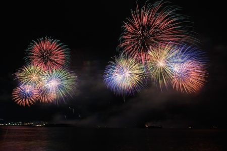 colorful fireworks on the sea photo