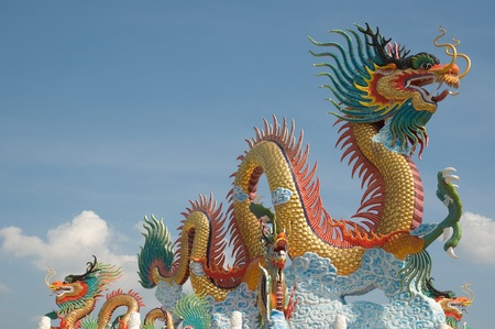 the red dragon: Chinese dragon statue with blue sky Stock Photo