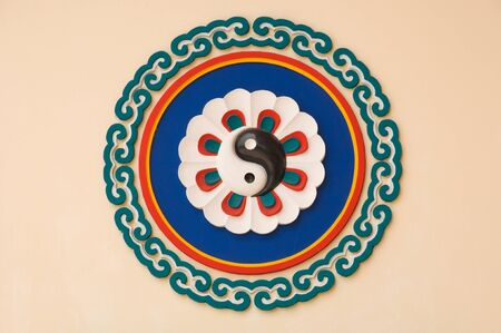 oriental medicine: yin yang symbol on Chinese temple wall