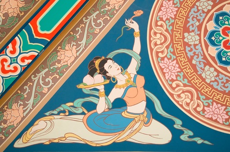 painting angel  on chinese temple roof photo