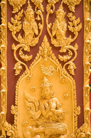 Thai art stucco on the wall at Wat Phramahajedi Chaiyamongkol Roi Et province Thailand photo