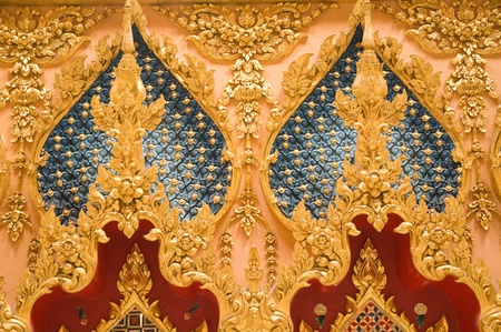 Thai art stucco on the wall at Wat Phramahajedi Chaiyamongkol Roi Et province Thailand